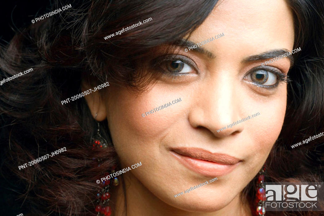 Stock Photo: Portrait of a young woman grinning.