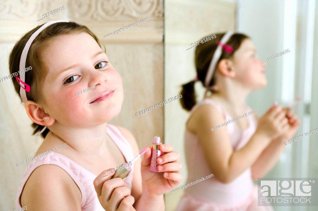 Stock Photo: Little girl applying make up.