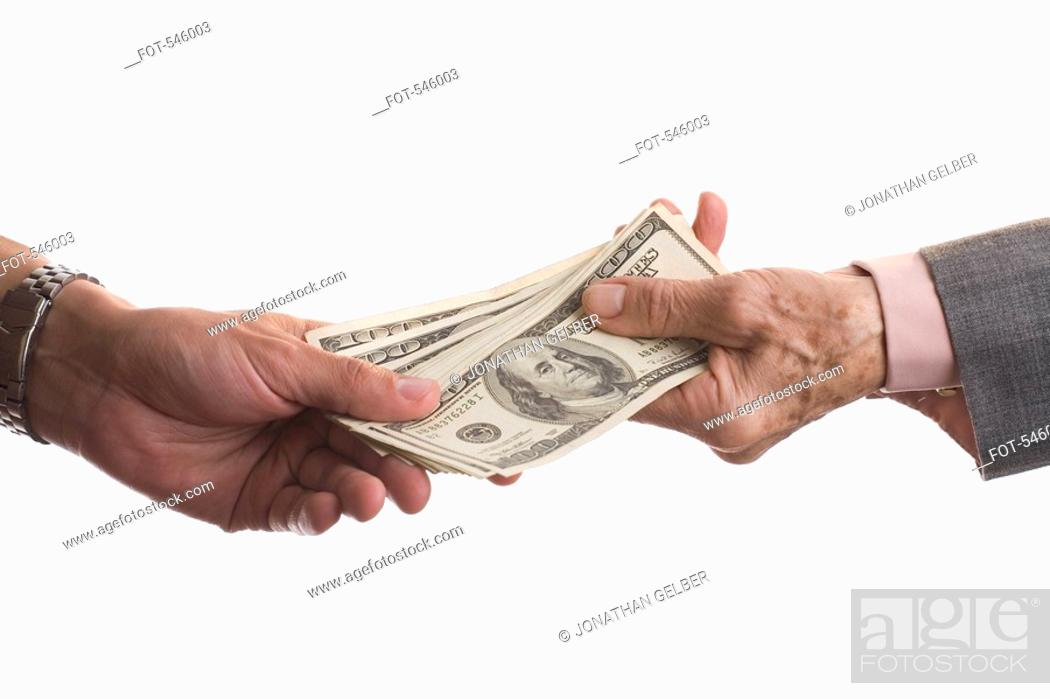 Stock Photo: Detail of two people exchanging money.