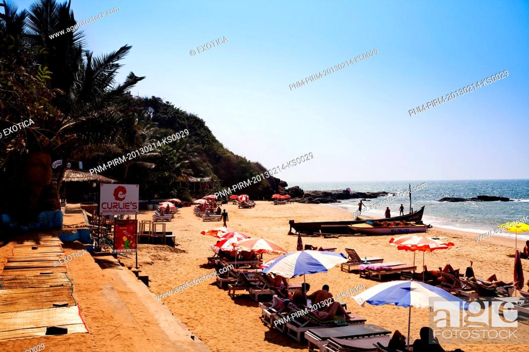 Stock Photo: Tourists on the beach, Curlies Bar and Restaurant, Anjuna, North Goa, Goa, India.