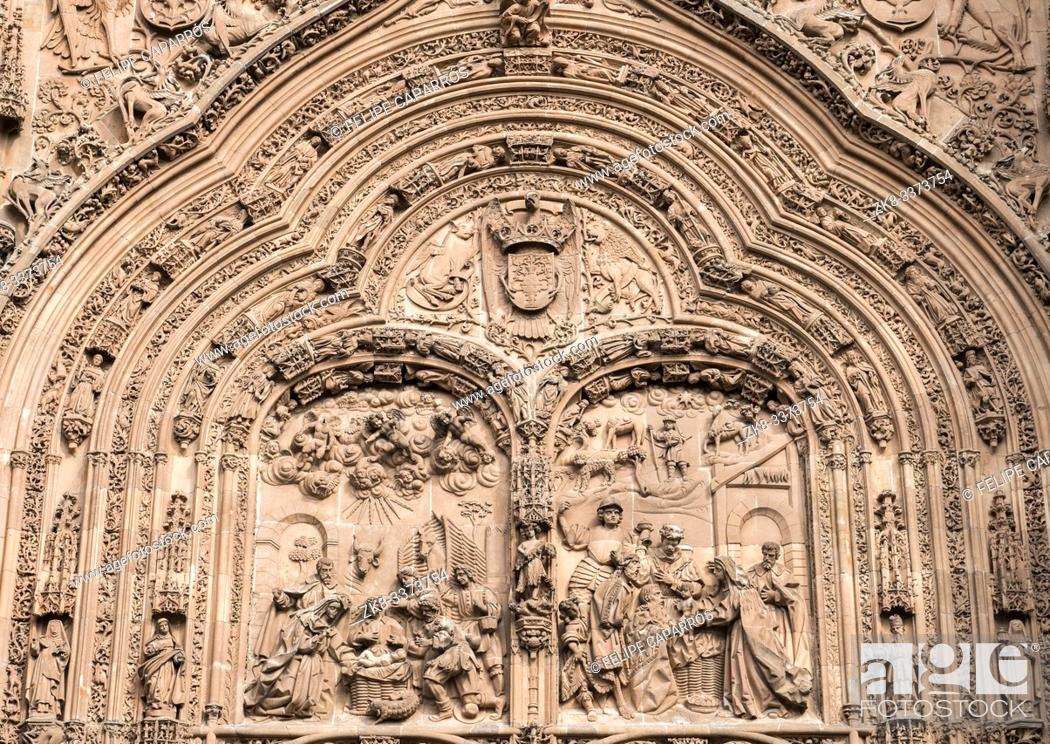 """Stock Photo: Salamanca, España - August 18, 2019: Detail of the main cover of the cathedral called the """"""""portada de ramos"""""""", sculptural group of the Entrance of Jesus in."""