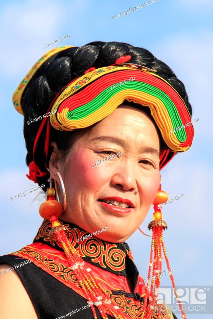 Stock Photo: Heqing, China - March 15, 2016: Chinese girl in traditional Miao clothing during the Heqing Qifeng Pear Flower festival.