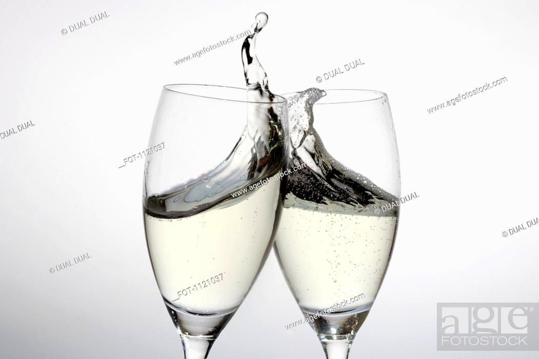 Stock Photo: Toasting with two glasses of champagne.
