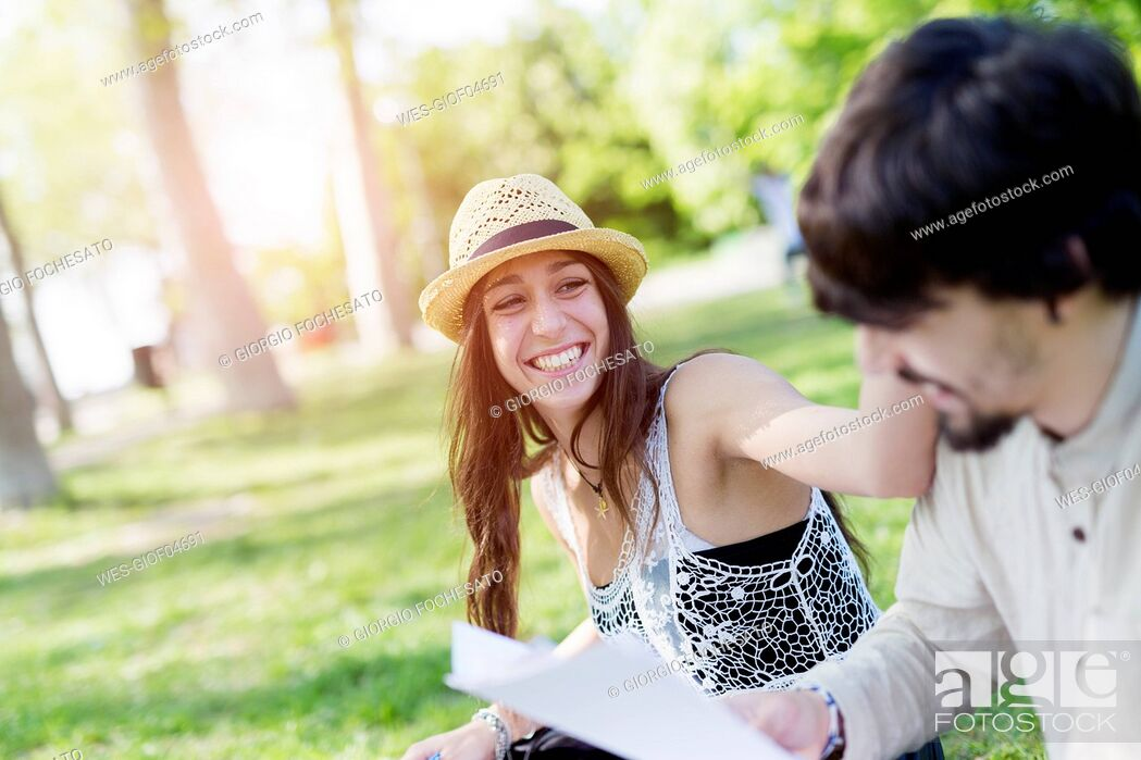Stock Photo: Portrait of laughing young woman having fun in a park with her fellow student.