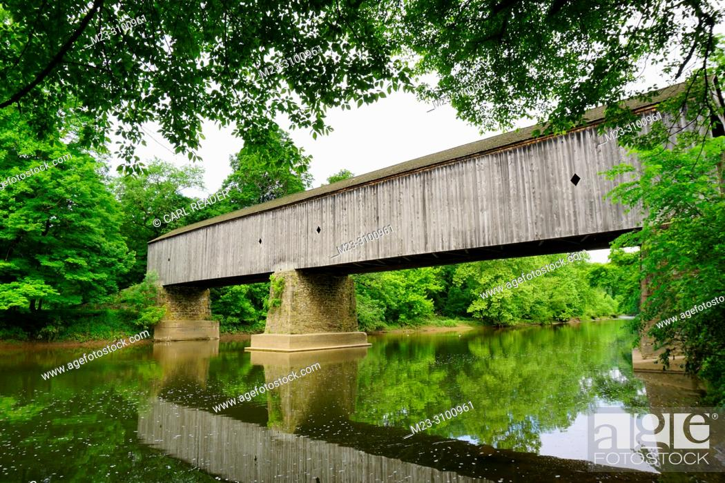 Stock Photo: A lazy summer day for an old wooden covered bridge, Pennsylvania, USA.