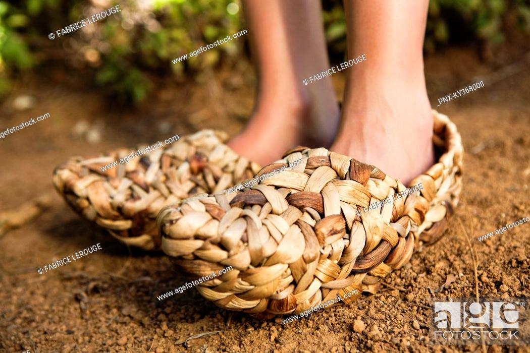Stock Photo: Low section view of a woman wearing wicker shoe.