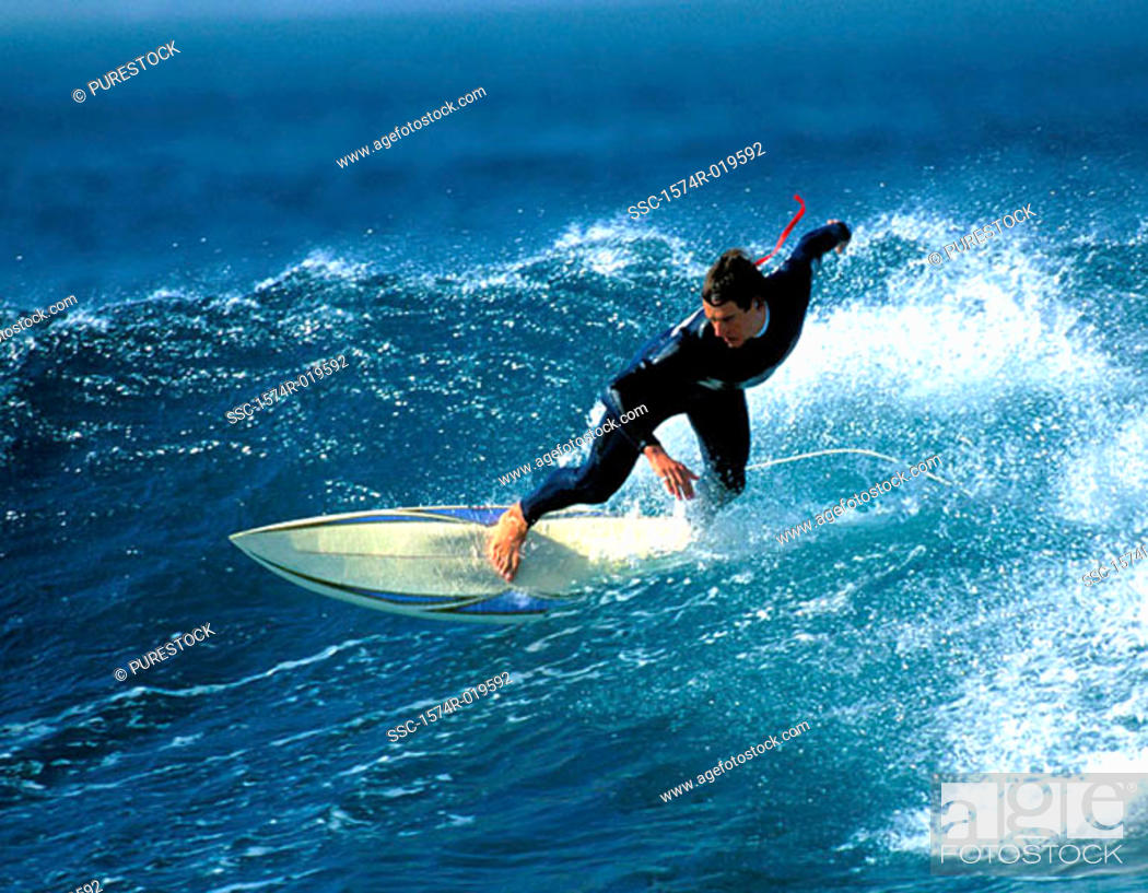 Stock Photo: High angle view of a mid adult man surfing in the sea.