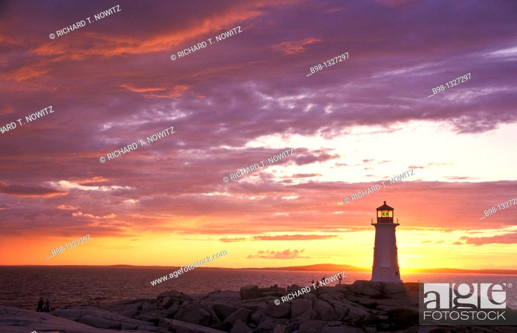 Stock Photo: Peggys Cove Lighthouse Silhouetted at Sunset.