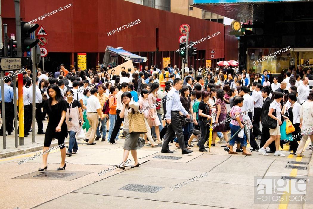 Stock Photo: Crowd walking in a street, Hong Kong Island, Hong Kong, China.