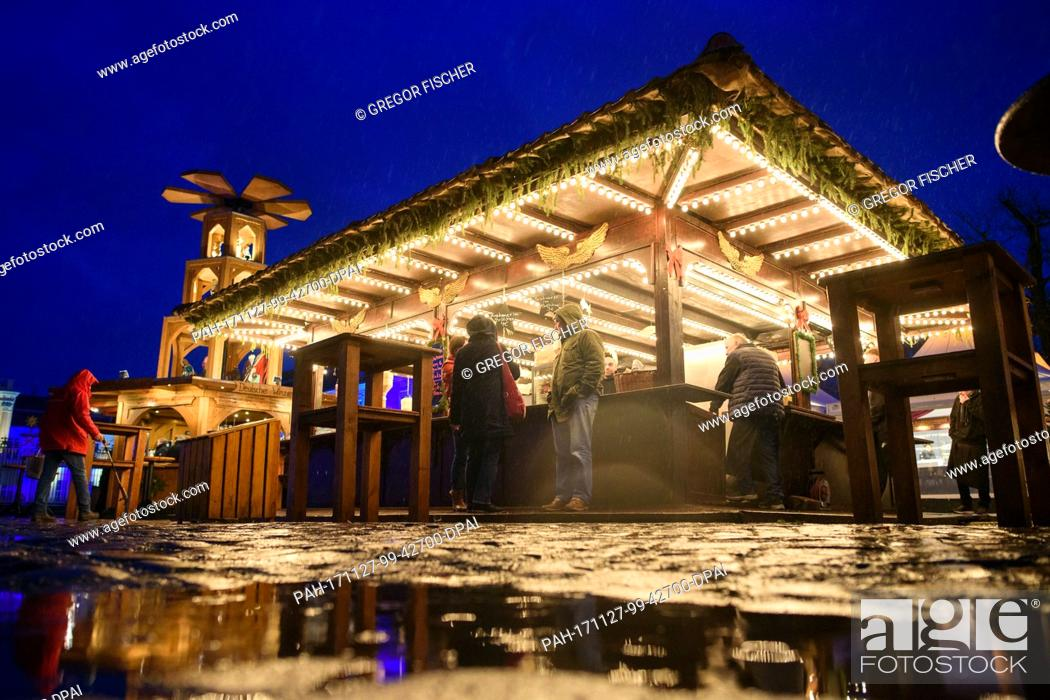 Stock Photo: Few visitors stand at the stands of the Christmas market in front of Charlottenburg Palace in Berlin, Germany, 27 November 2017.