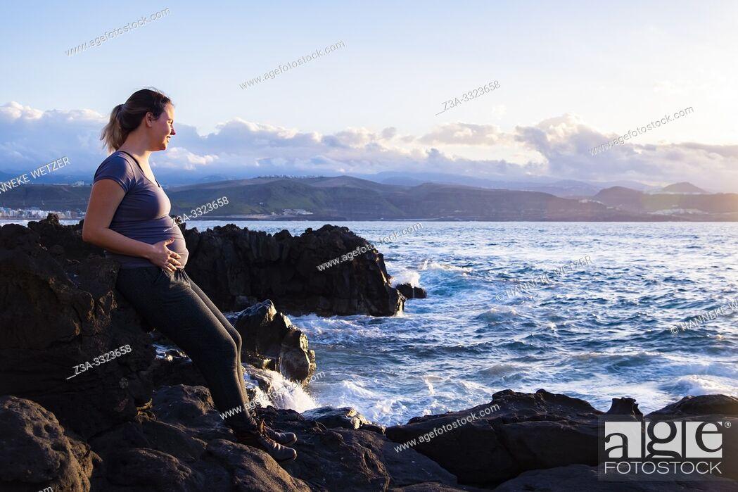 Stock Photo: Pregnant woman enjoying the coastline of Las Palmas, Canary Islands.
