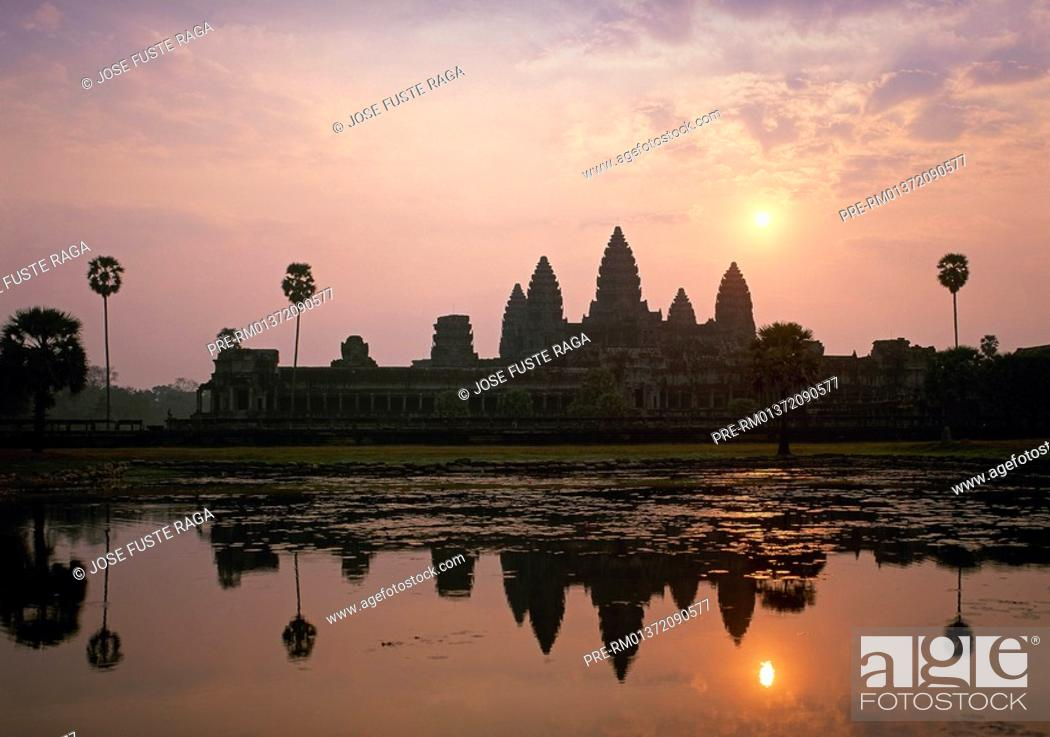 Stock Photo: Reflection of Angkor Wat temple silhouette in the temple lake, Angkor, near Siem Reap City, Cambodia, Asia.