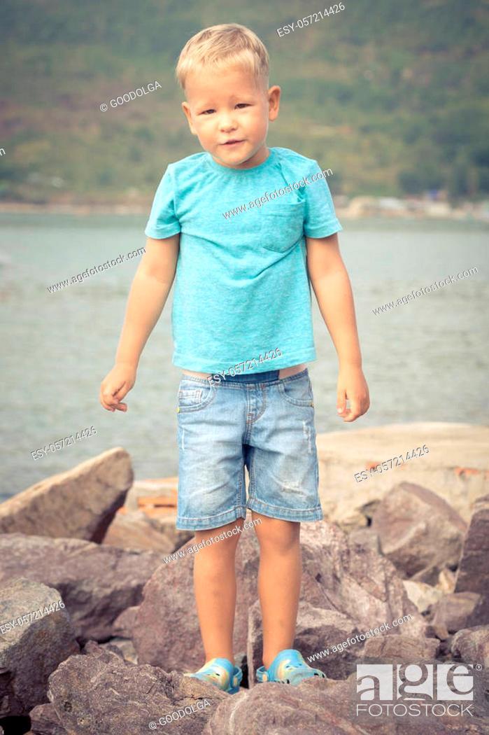 Stock Photo: Cute caucasian boy at seaside. Leisure time.