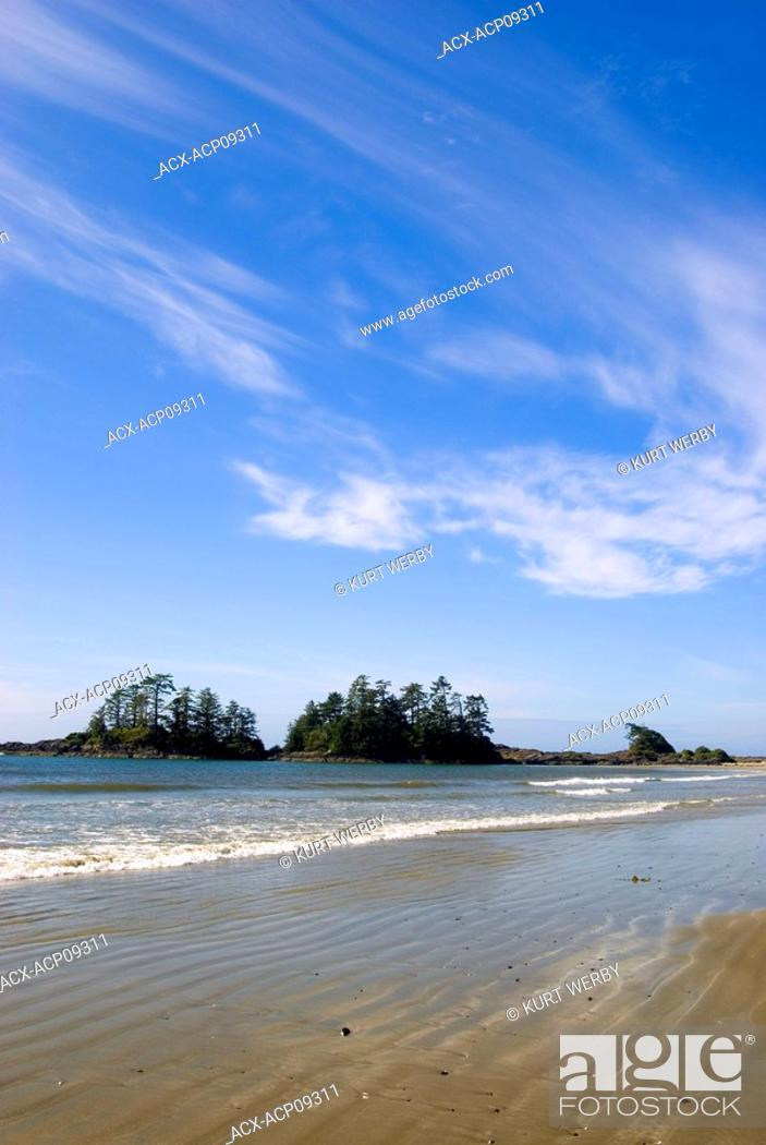 Stock Photo: A sunny day with whispy clouds at Chesterman Beach near Tofino, Vancouver Island, British Columbia, Canada.