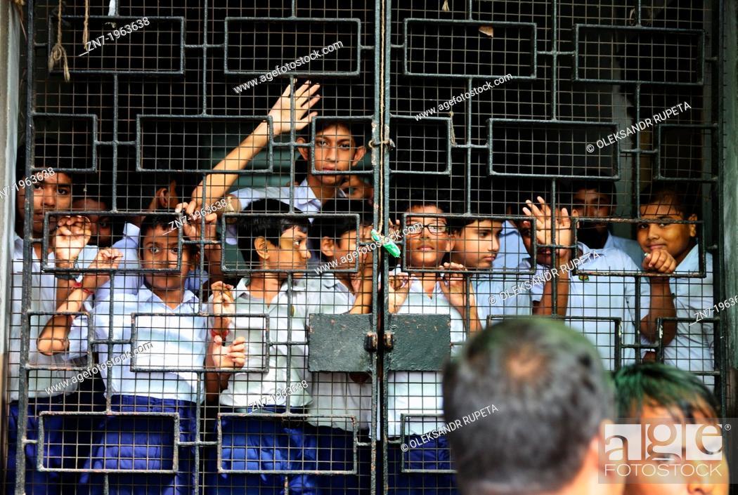 Stock Photo: Pupils behind bars, College Street, Kolkata, India.
