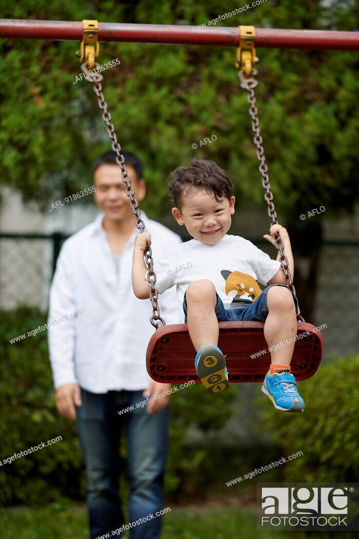 Stock Photo: Japanese family in a city park.