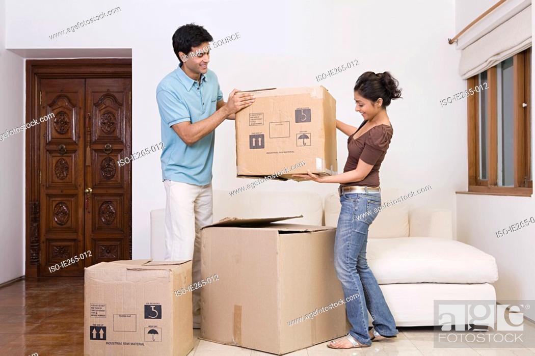 Stock Photo: A couple lifting boxes.