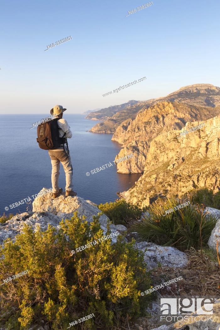 Stock Photo: South sector of the Serra de Tramuntana and S'Evangelica mountain with hiker, Andratx, Majorca, Spain.