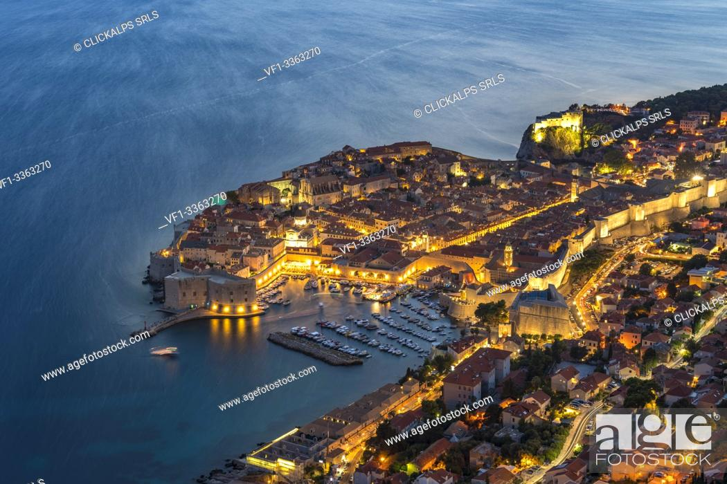 Stock Photo: The town at dusk from an elevated point of view. Dubrovnik, Dubrovnik - Neretva county, Croatia.