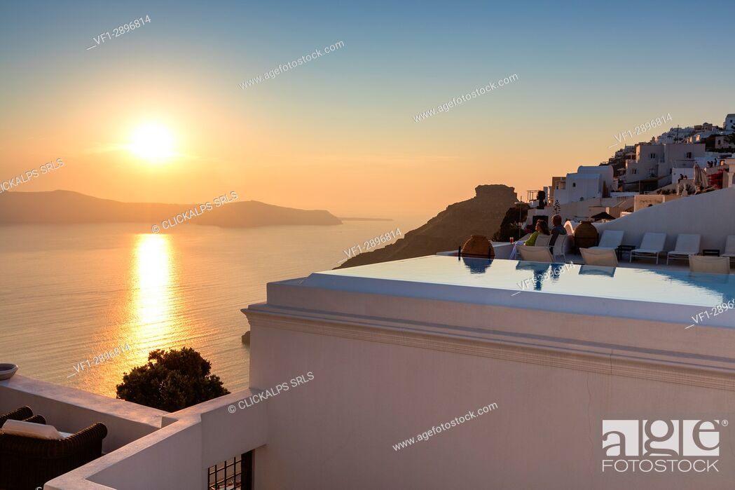 Stock Photo: Sunset over the Aegean Sea seen from the old village of Firostefani Santorini Cyclades Greece Europe.
