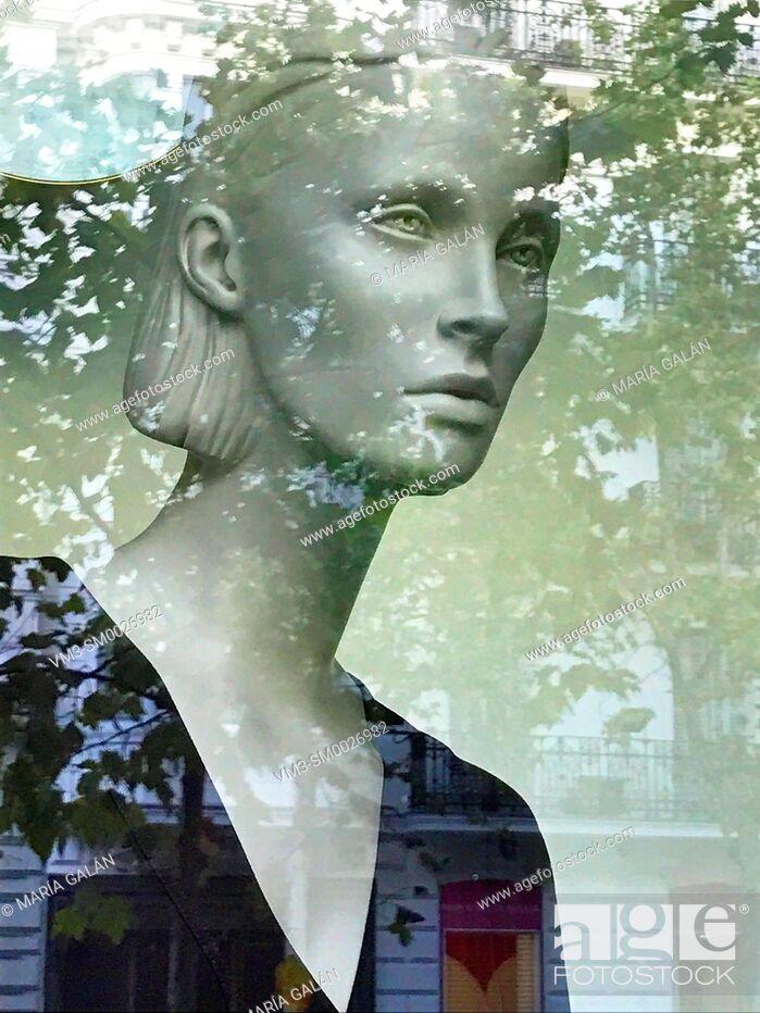Stock Photo: Mannequin in a shop window. Serrano street, Madrid, Spain.