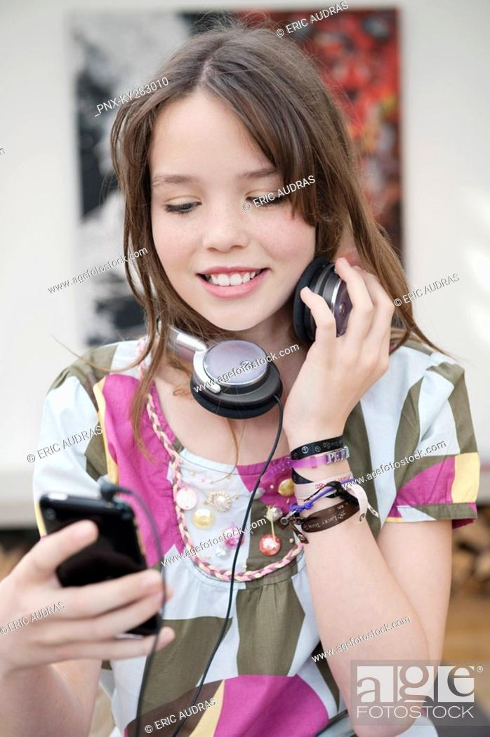 Stock Photo: Girl listening to an MP3 player.