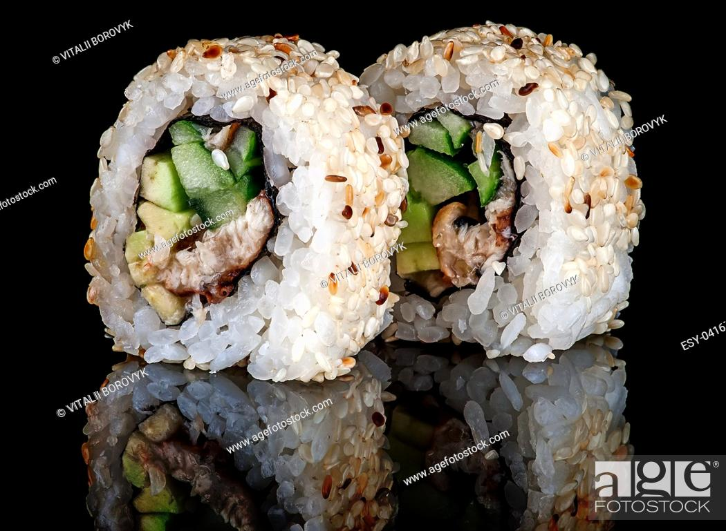 Stock Photo: Closeup two sushi roll california on black background. Sushi roll with eel, vegetables and unagi sauce. Reflection.