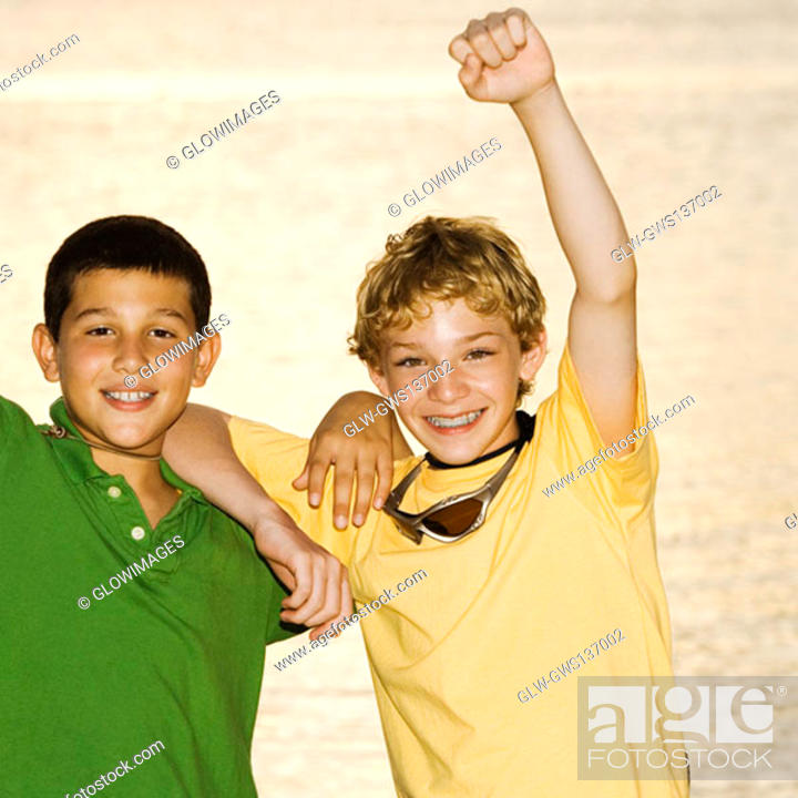 Stock Photo: Portrait of a boy and a teenage boy smiling.