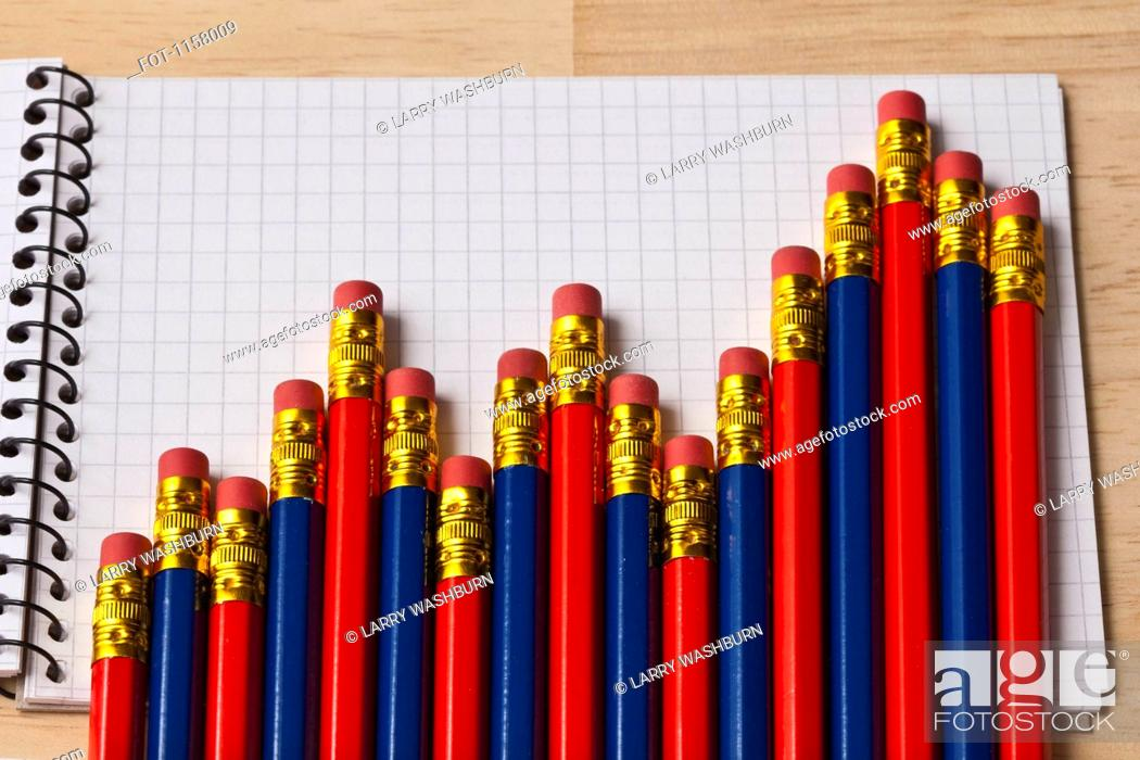 Stock Photo: A bar graph made from the eraser end of blue and red pencils.