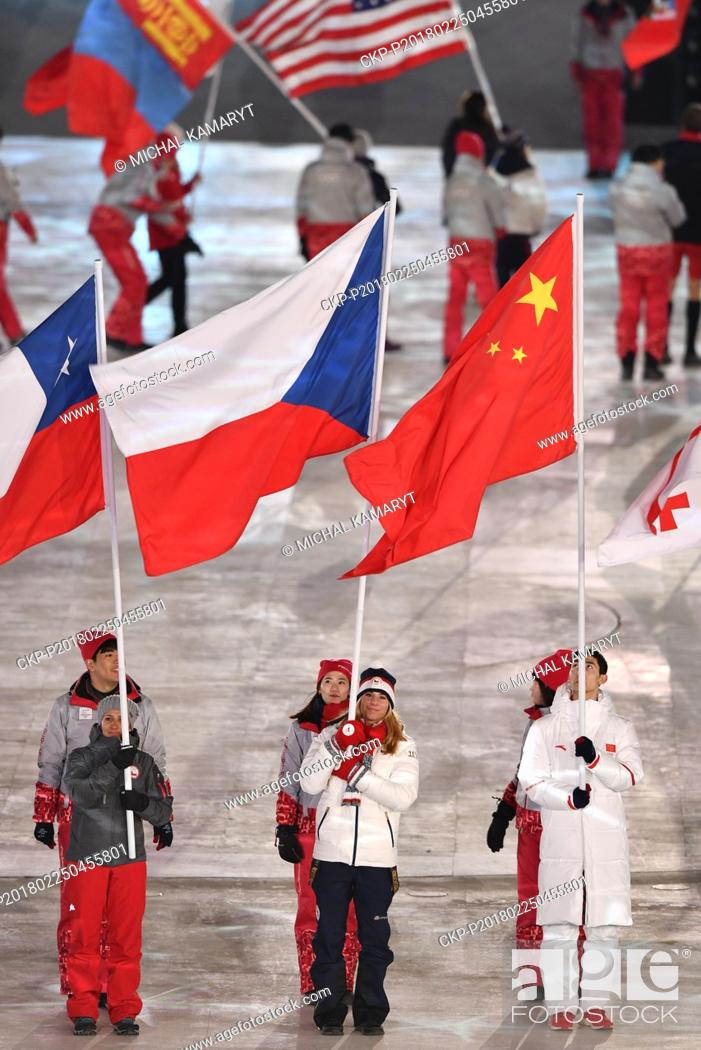 Czech snowboarder Ester Ledecka, center, carries the flag of the