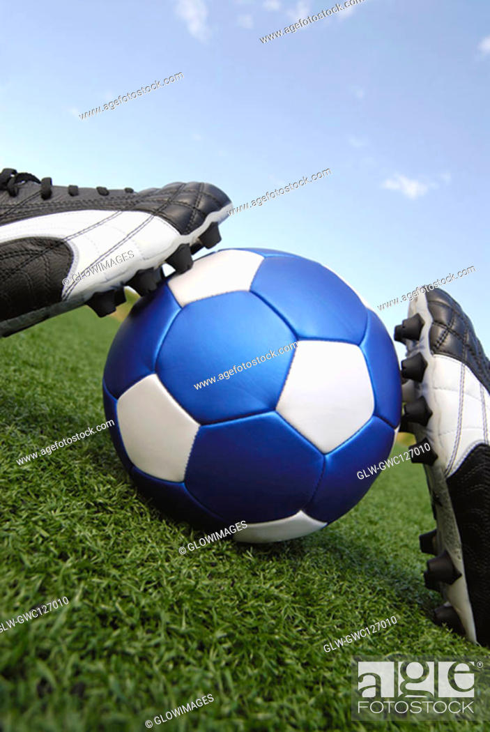 Stock Photo: Close-up of soccer shoes and a soccer ball.