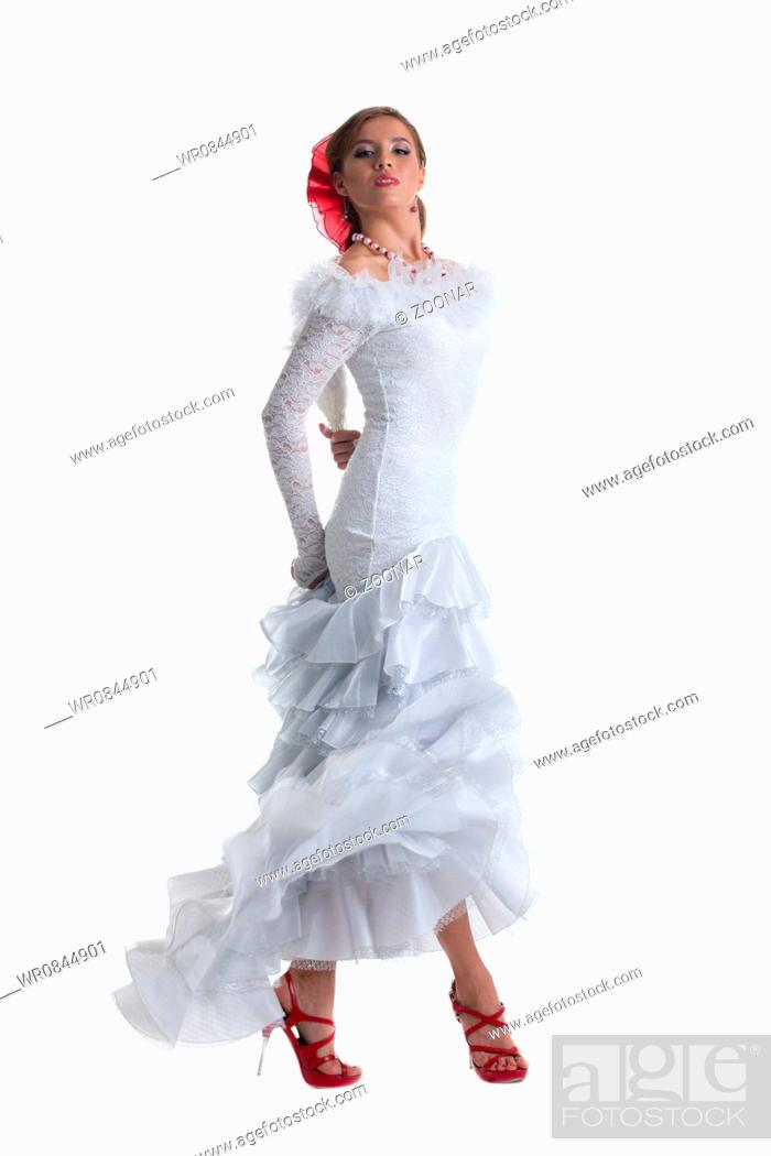 Stock Photo: Pretty woman in white dress performing flamenco.