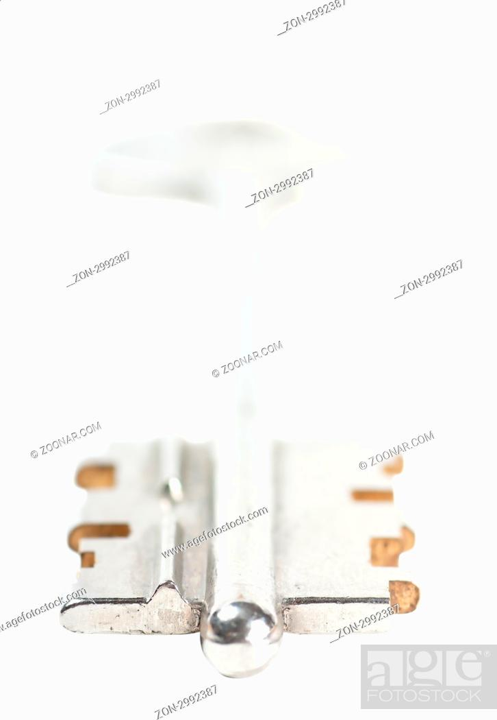 Photo de stock: A key isolated over white background.