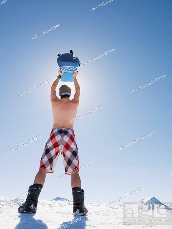 Stock Photo: topless man with snowboard.