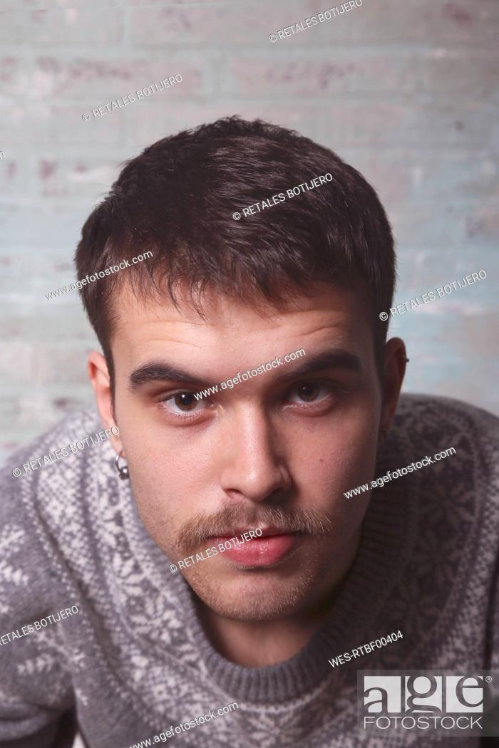 Stock Photo: Portrait of young man with a mustache wearing winter sweater.