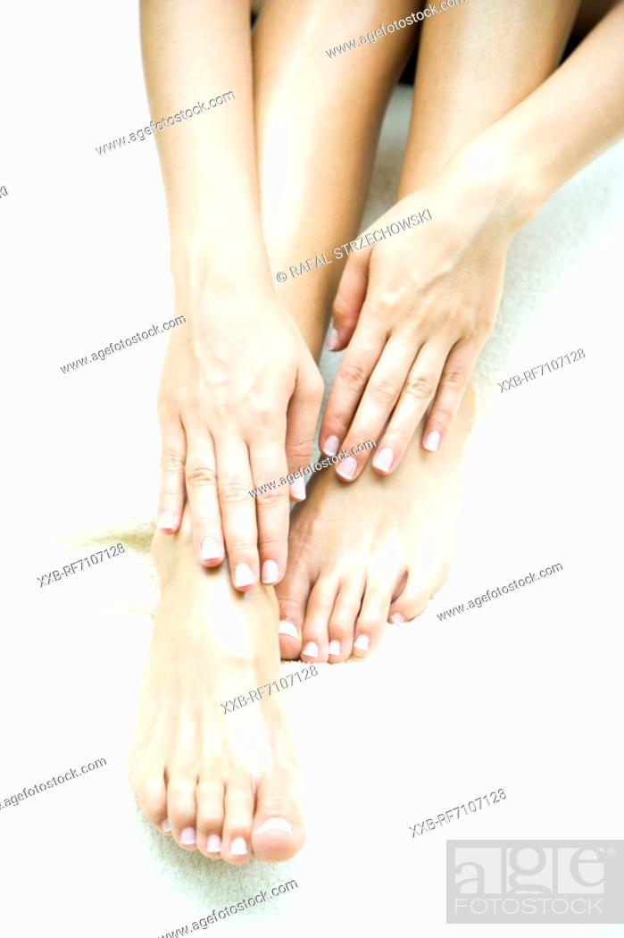 Stock Photo: Feet and hands close up.