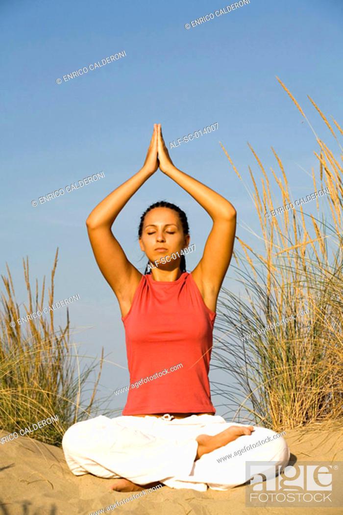 Stock Photo: Young woman doing yoga exercises.