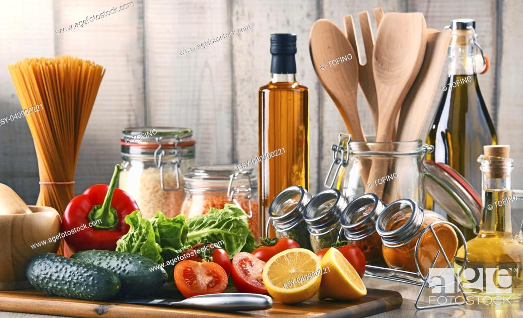 Stock Photo: Composition with assorted food products and kitchen utensils on the table.