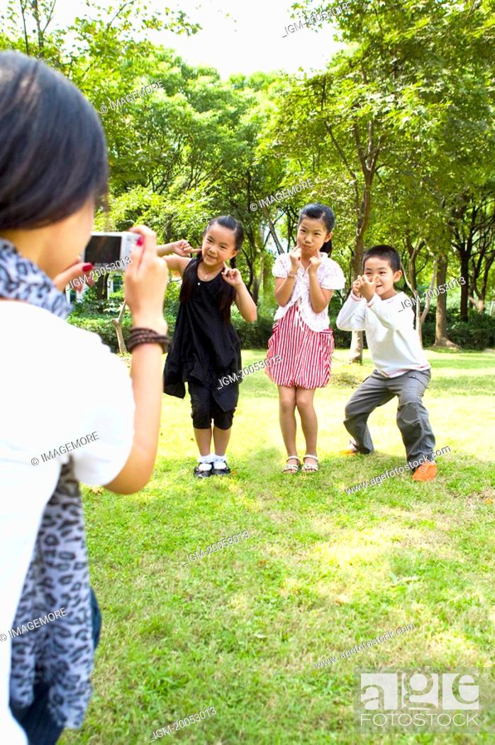Stock Photo: Children in park, posing for taking pictures.
