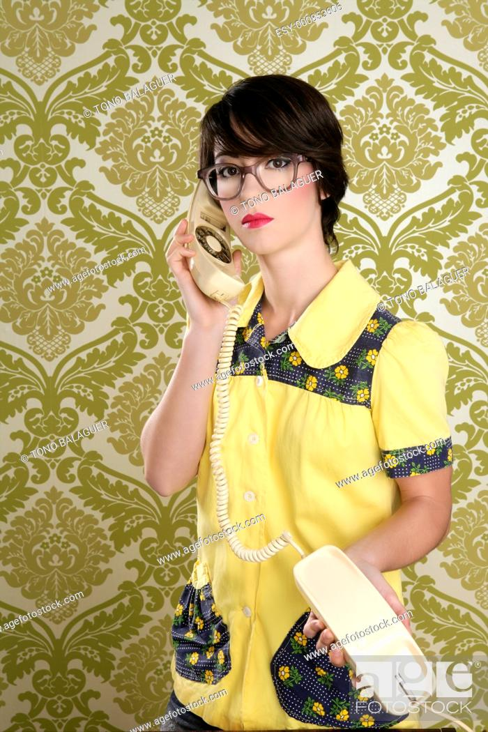 Stock Photo: nerd housewife retro woman dial vintage wired phone 70s wallpaper.