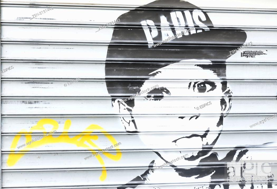 "Stock Photo: black and white stencil portrait of a boy wearing a baseball cap with the writing """"paris"""", paris, ile de france, france."