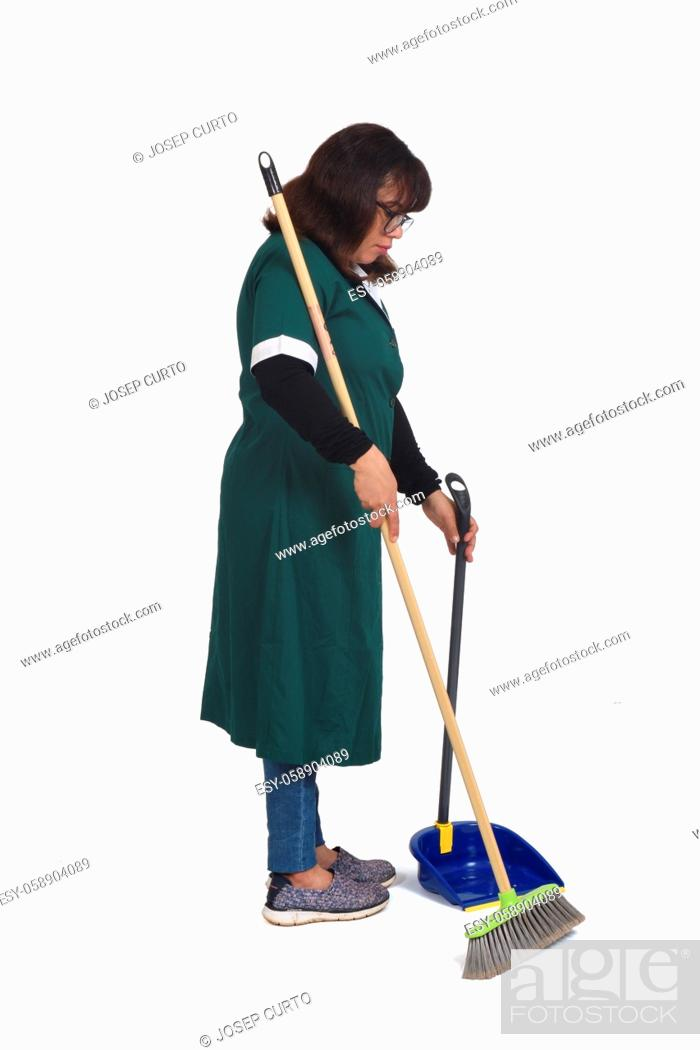 Stock Photo: side view of a cleaning woman who is sweeping with a dustpan over white.