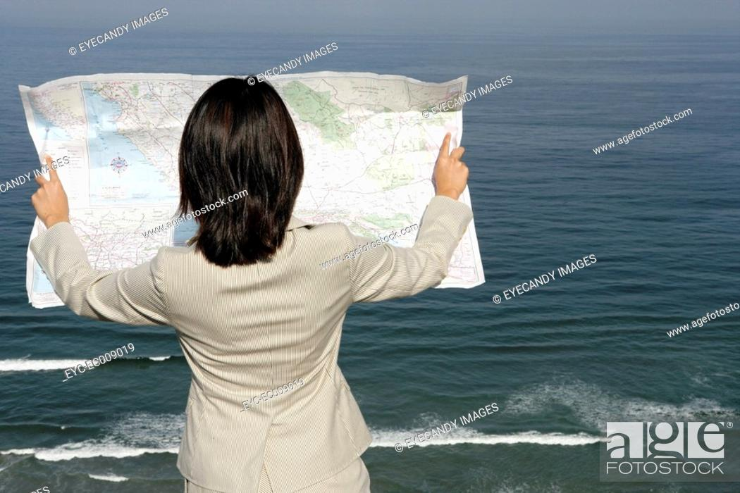 Stock Photo: View of a woman reading a map.