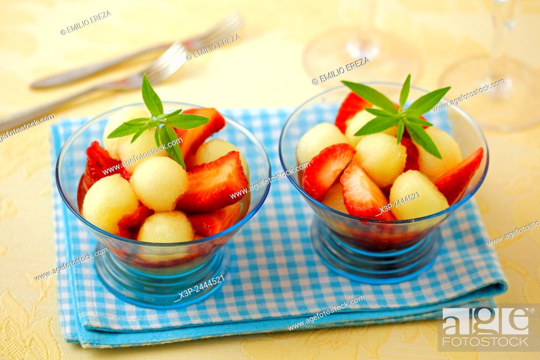 Stock Photo: Strawberries and melon with light infusion.