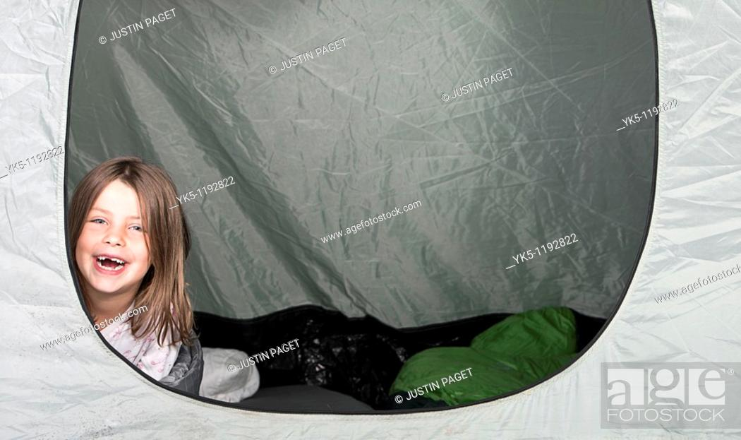 Stock Photo: Shot of a Young Girl with a Big Smile in her Tent.