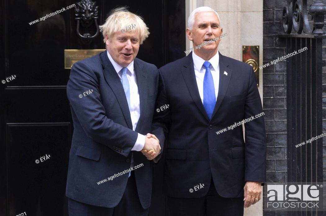Stock Photo: (190905) -- LONDON, Sept. 5, 2019 () -- British Prime Minister Boris Johnson (L) greets U.S. Vice President Mike Pence at 10 Downing Street in London, Britain.