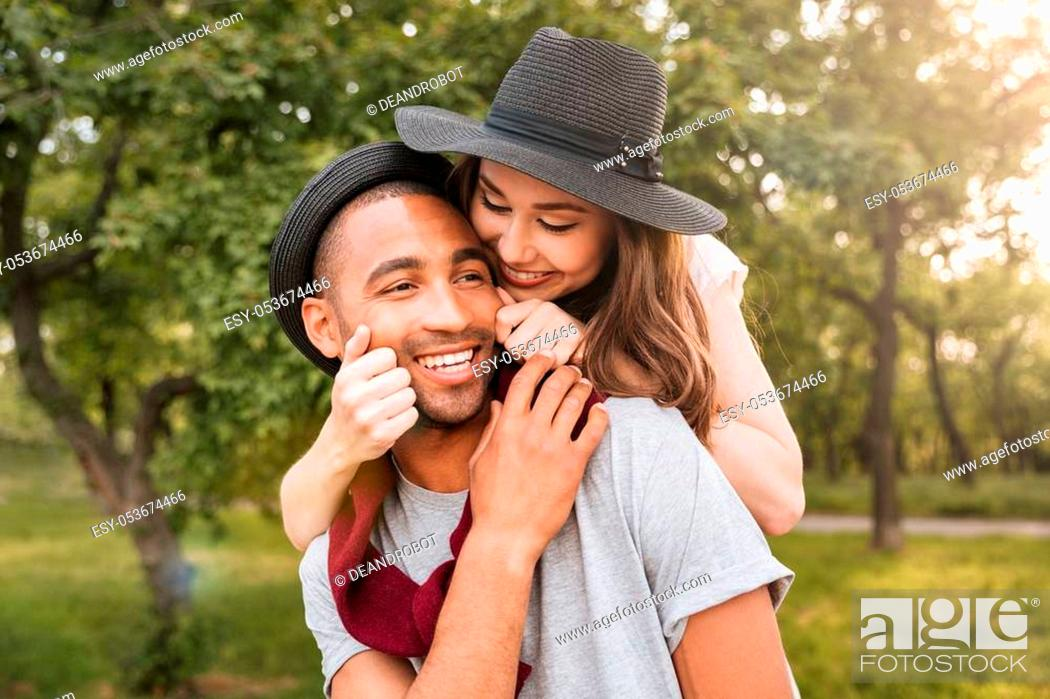 Stock Photo: Smiling beautiful young couple in love having fun in park.