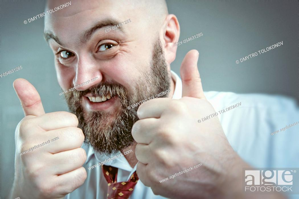 Stock Photo: Everything fine. Male Portrait with positive expression.