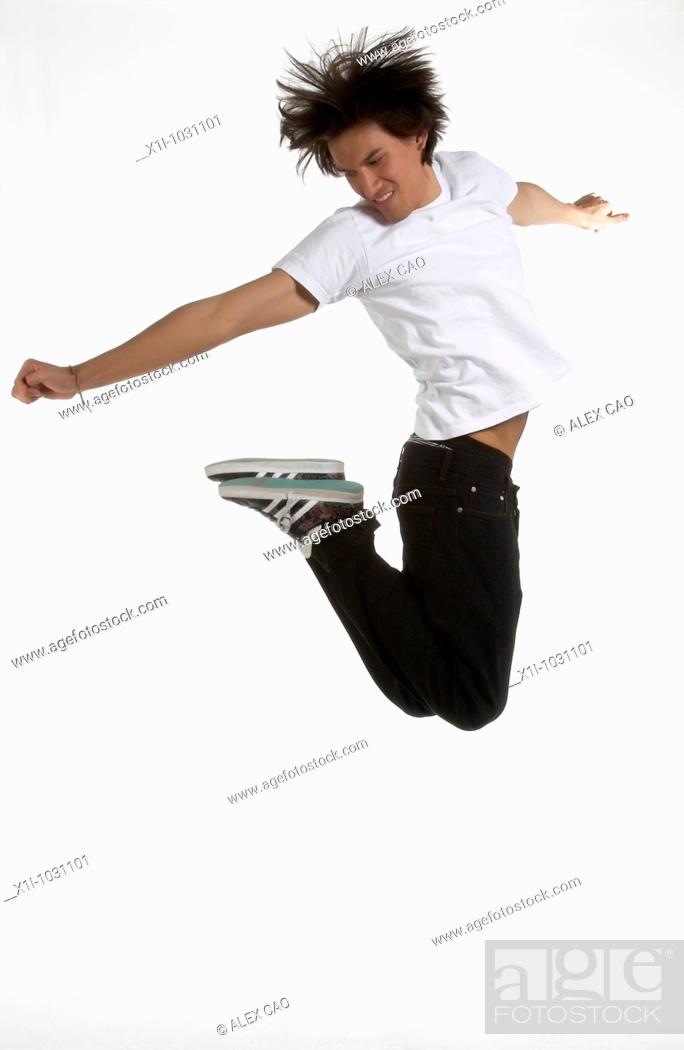 Stock Photo: Guy Jumping in the air.