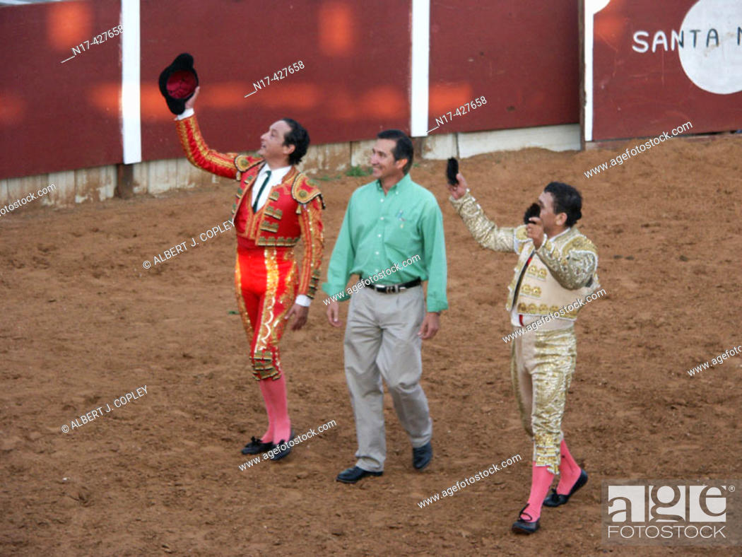 Stock Photo: Bullfighters' grand entry into arena.